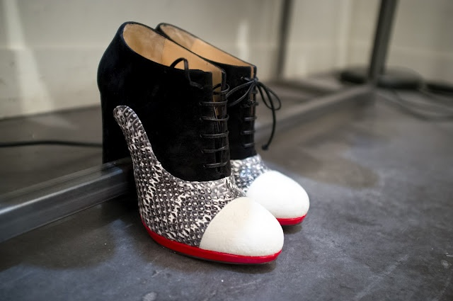 Cute tie up ankle boots with black and white snakes skin and blood red outlining. Perfect for winter outfits!