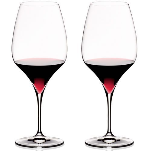 """Riedel Vitis Syrah / Shiraz Wine Glasses  This stemware is specifically designed to capture, enhance and translate the aromas and tastes of Shiraz wines. Riedel's Vitis line is made with a seamless pulled stem and an """"architecture"""" design feature that reflects light from the bottom of the bowl"""