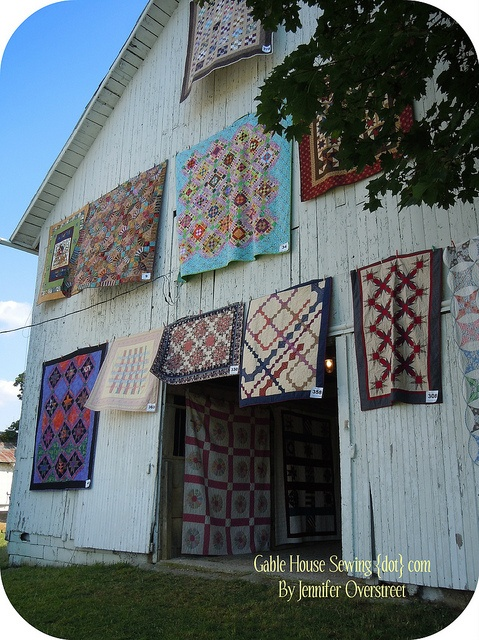Quilts hanging on barn