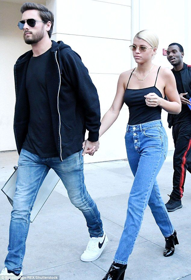 Hand in hand: Disick held hands with girlfriend Richie in Los Angeles in December 2017...
