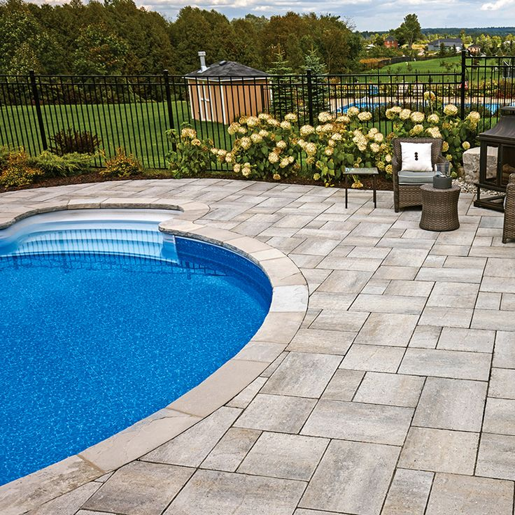Poolside landscape. Project application using Villanova pavers. Color: Villanova Champagne by Oaks Landscape Products.