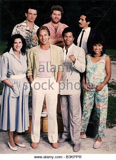 MIAMI VICE US TV series with Don Johnson (in white trousers) and Phillip Michael Thomas next to him Show ran from - Stock Image