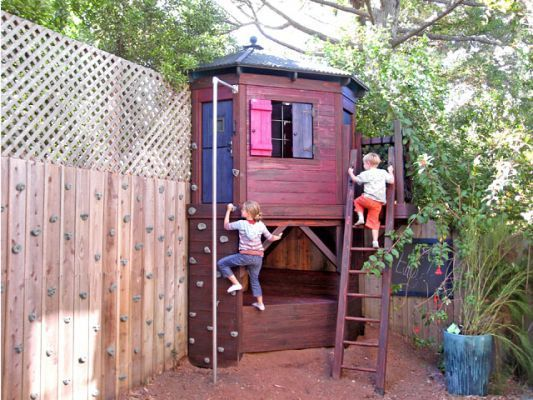 Love this corner play house.Great for a small backyard. Neat rock wall too.        Specifications  Corner Playhouse is designed to fit inany corner, up against a wall or fence, with minimum intrusion into the yard and maximumplay features. A small dynamo of a playhouse with a rock climbing wall, firepole, rung ladder, upper & lower play space and interior drop leaf table with 2 drop seats!