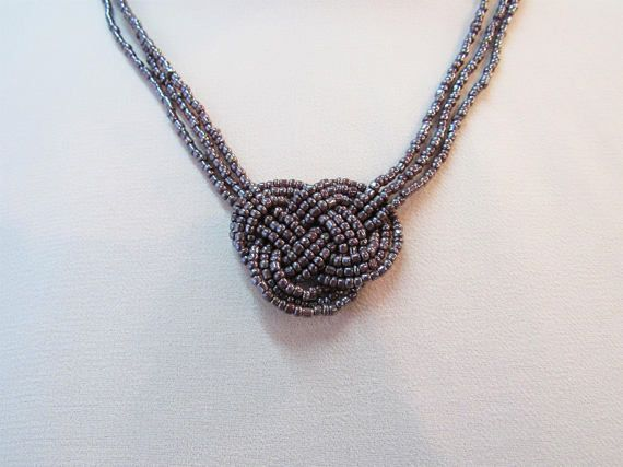 Multistrand necklace with Josephine's knot, Triple Moebius knot