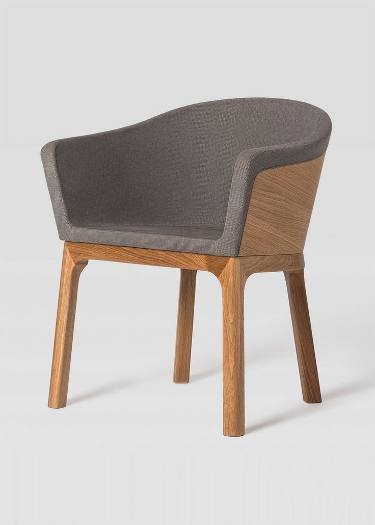 The Paletta Arm Chair is solid wood with an upholstered seat.