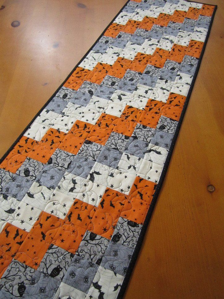Quilted Halloween Table Runner in Gray and Orange with Bats, Owls and Spiders by patchworkmountain.com