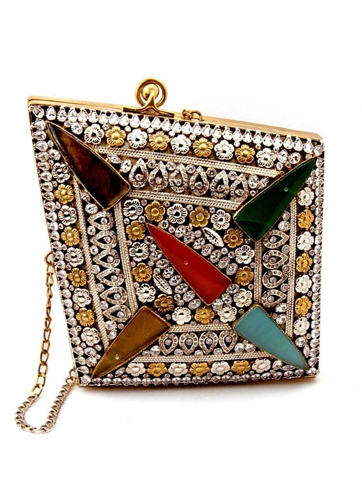Exquisite golden color designer #Clutch  #Purse made from brass metal studded with multicolor stones. Item Code:SJBP2022 http://www.bharatplaza.com/new-arrivals/accessories.html