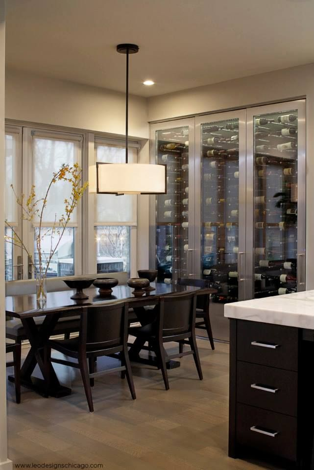 Check out the wine cooler in this dining room by Leo Designs Chicago.
