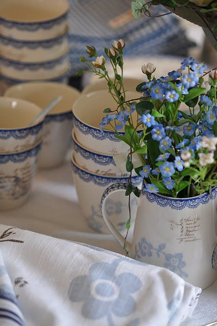 Charming blue and White tea cups and linens decorate this sweet table.   Perfect for a baby boy shower!   www.modernmagnolia.net