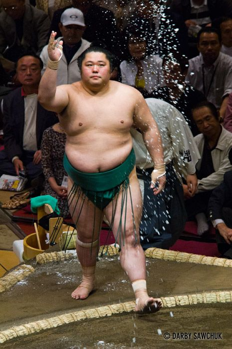 A sumo wrestler tosses salt to purify the ring at the Ryogoku stadium in Tokyo, Japan.༺ ♠ ŦƶȠ ♠ ༻