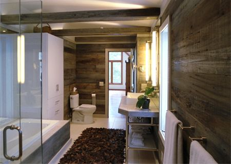 A modern bathroom with lots of timber panelling.