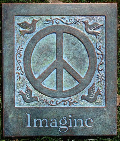 Here we have a hanging concrete peace plaque.  Perfect house warming, anniversary, or birthday gift. Not looking for a gift? Treat yourself! This is NOT a store bought mold. This is an original design and handmade by the Harland family.  Hand painted with an outdoor protective paint, so you can hang this outside in any weather and the color will stay. There is a copper wire embedded in the back, easy to hang.  This plaque is the perfect gift for your garden or inside your home.  Measures: 9w…