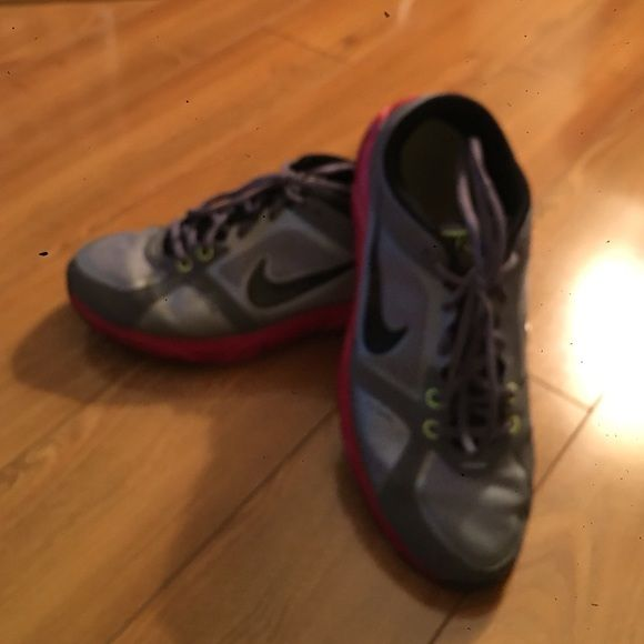 Womens Nike sneakers Womens Nike sneakers size 9 in good condition. Worn a few times with some minor scoffs. Sneakers are gray, pink, and black Nike Shoes Sneakers