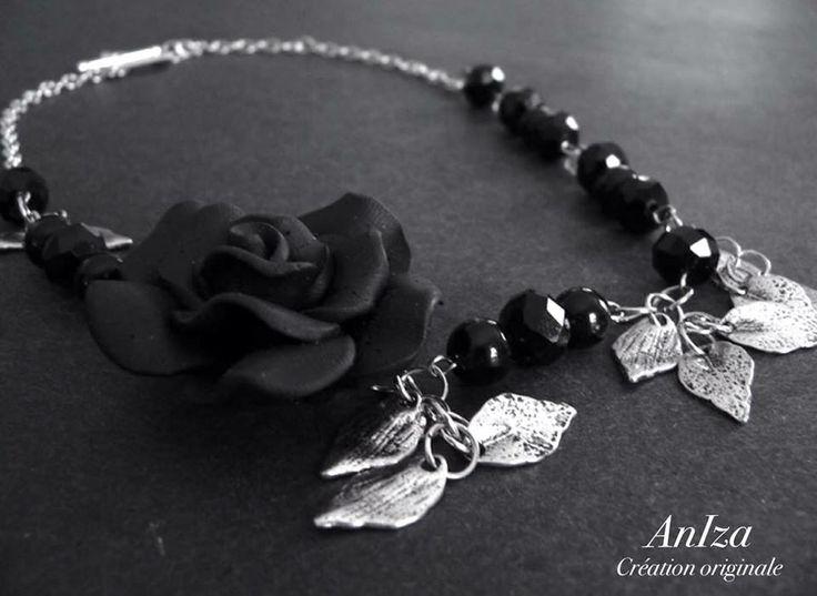 fleur noire et feuilles argent, fait par Annie