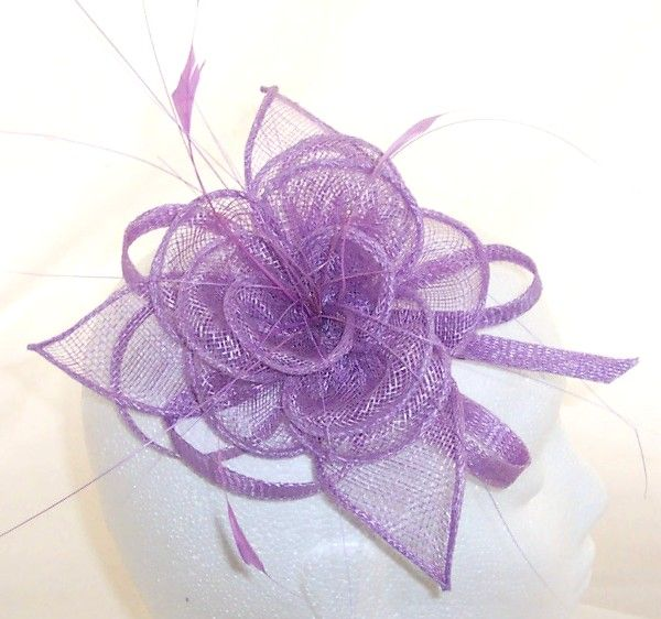 Lilac Fascinator With Large Sinamay Flower Corsage on a concord clip, fashioned from feathers and stiffened sinamay flower perfect wedding accessory