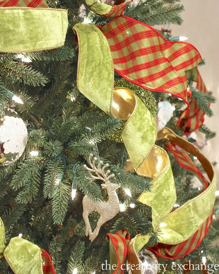 Quick trick for how to beautifully work in and layer ribbon in Christmas trees, wreaths and centerpieces.  The Creativity Exchange