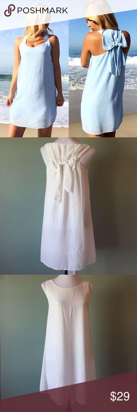 White bow back dress BNWT medium Brand new with tags. Gorgeous white bow back dress. Flowy and fully lined. So pretty. Size medium Dresses Mini