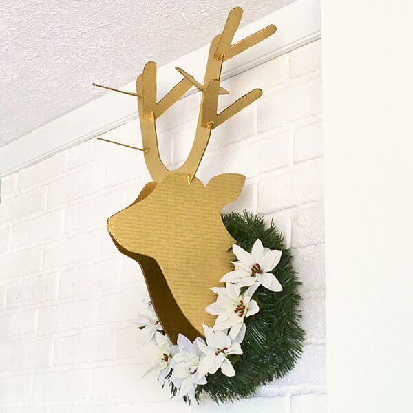 This DIY cardboard deer head is fun and inexpensive kitsch for Christmas, winter or anytime really. Decorate as you see fit. Mine was $6!