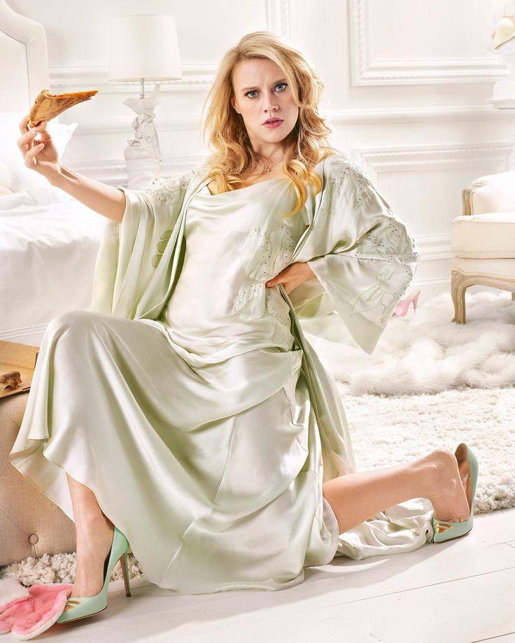Kate McKinnon spotted wearing Josie Natori silk gown and robe. Shop similar styles at natori.com