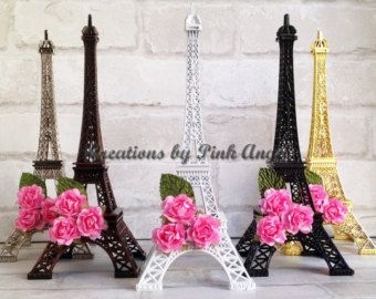 This listing is for 1 Metal Eiffel Tower Centerpiece plain or decorated as shown, your choice. Great for your Paris Wedding, Bridal Shower, Baby shower, or any other event. Measurements: 15 height x 6 width x 6 length. Tower is detachable (comes in 2 parts: top and bottom) assembly: just place the top part into the bottom part and click in place. ***THIS ITEM SHIPS OUT PRIORITY MAIL*** (If purchasing in bulk I might use UPS Ground) Also available in: ---6 Black, Silver, Gold, and Bronze --10…