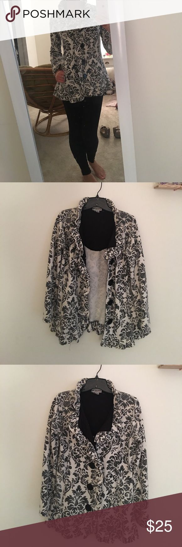 Fall/Light Coat It's a cute black and white design great for semi chilly weather but still being fashionable! Honestly got the coat in the adolescent section of Khols but it still looks very fashionable and fits! Great coat for the big city stylish look! Jackets & Coats