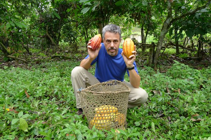 Chris holds up two beautiful, ripe cocao pods at a small scale organic farmer's association in Ecuador.