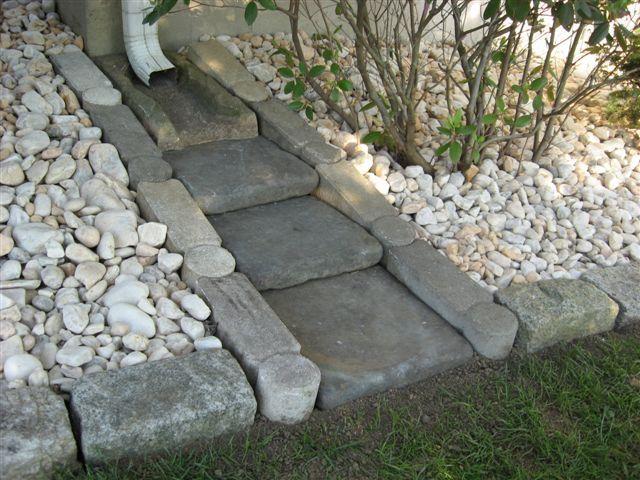 Stone Rain Gutter Splash Block- a look that isn't tacky! - tomorrows adventures   tomorrows adventures