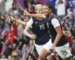 Abby Wambach of the U.S. celebrates scoring against North Korea with team mate Megan Rapinoe during their women
