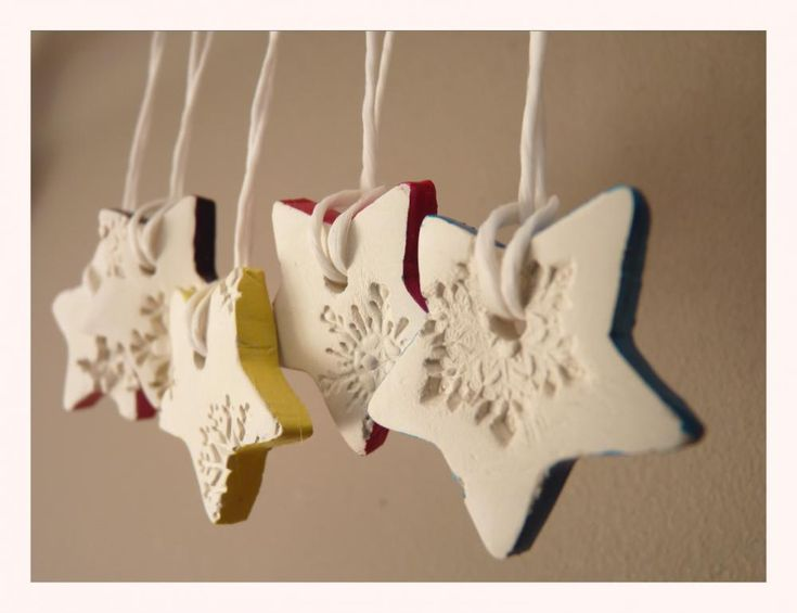 Snowflake porcelain ornaments, white and multi-colored, star shaped. #ornaments #decoration