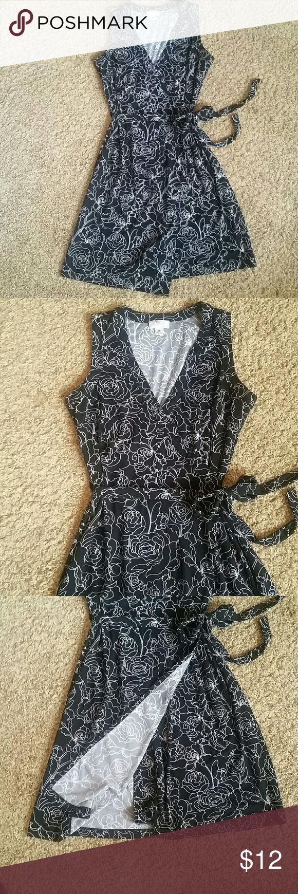 Fun and Flirty Wrap Dress from LOFT Black dress with White Floral Pattern. Like new condition LOFT Dresses