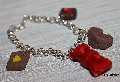 Bracciale in pasta polimerica. #handmade #rosso #dolcetto #fiocco #fimo #bracciale