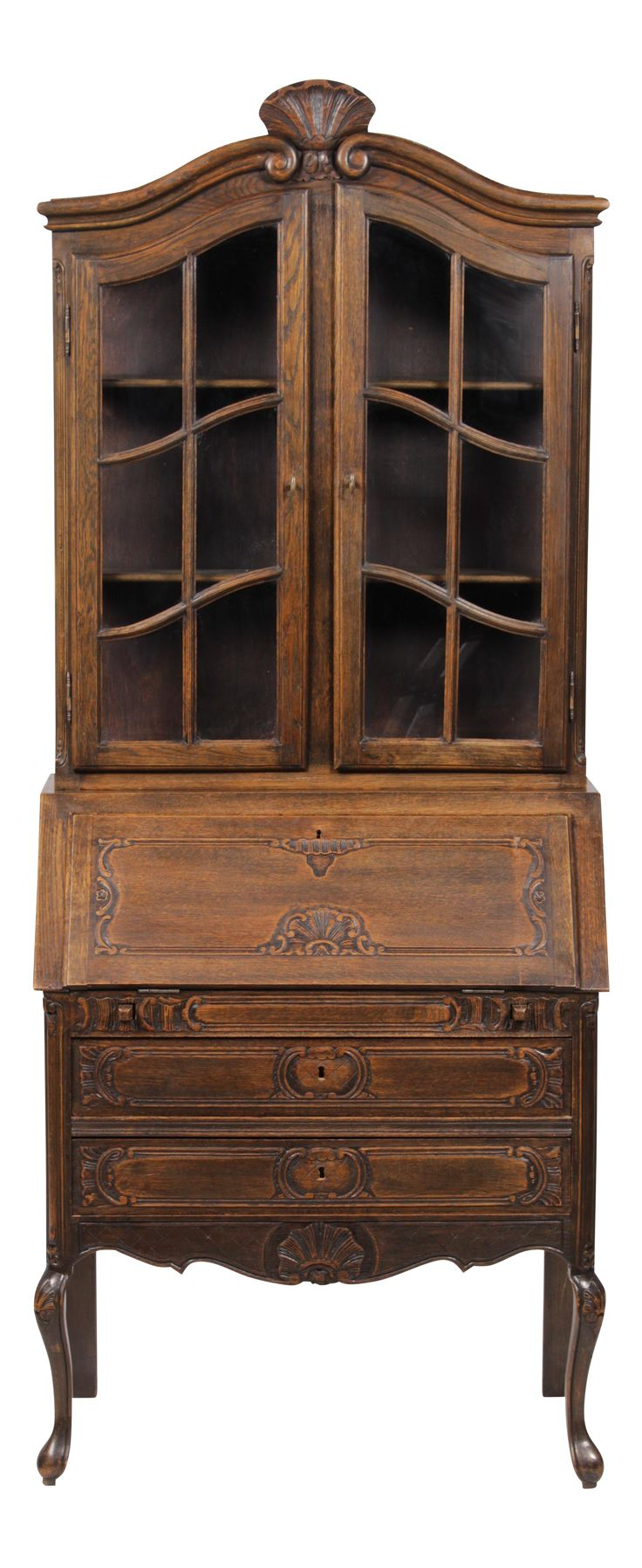1930s Belgian Louis XV-Style secretary made of solid oak featuring a blend of carvings and style, lovely double doors with shelves behind for display of books or china topped by a large carved shell and scrolls, base continues multiple shell motifs on drawers, legs and splay, secretary opens to reveal 5 letter drawers, base has 2 large document drawers and cabriole feet, key included.