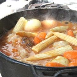chicken potjie: Melt in your mouth chicken, tender vegetable and tomato saucy goodness with a subtle white wine undertone.