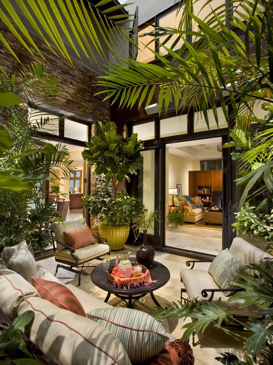 Patio With Indoor Garden With Sofa And Round Coffe Table
