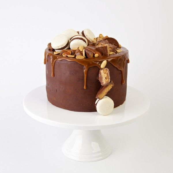 Snickers Layer Cake with Salted Caramel Peanuts, Chocolate Ganache and Chocolate Mud Cake. No recipe.
