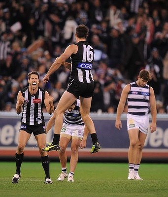 Collingwood's Nathan Brown and Jordan Russell celebrate beating Geelong at the MCG, 102 - 96. 18 May 2013