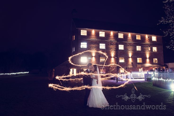 Sparkler newlywed photograph during wedding at Sopley Mill