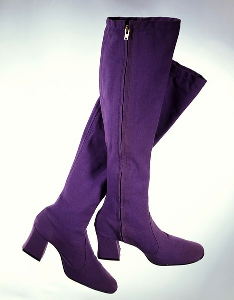 Vintage Biba Canvas Boots - 1969. The Biba boot was an essential item for the young and fashionable in the 1960s and early 1970s. This purple canvas pair perfectly illustrates the key elements. High chunky heels, square toes, sturdy side zips, and a moody colour were all typical. The boots were produced in a wide variety of colours, and were also made in suede. They were notoriously skinny-fitting and were said to cut off circulation, but Biba devotees still wore them, buying up multiple…