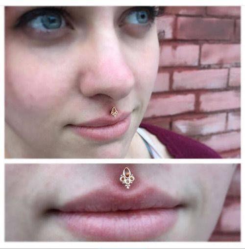 Philtrum piercing by Nate Janke of Saint Sabrina's. Jewelry by BVLA.