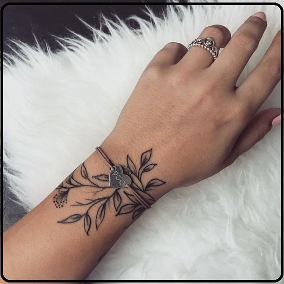 Beautiful women with tattoos - A tattoo is created out of