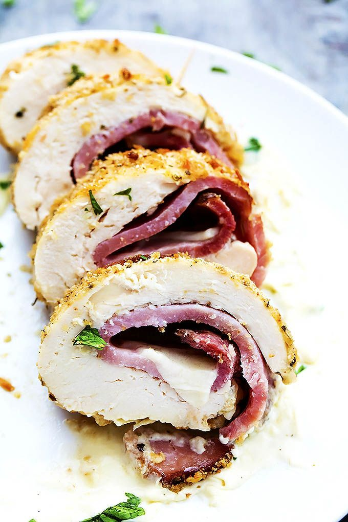 Chicken Cordon Bleu - chicken, ham, and swiss cheese rolled and lightly breaded, then baked to crispy perfection and topped with a rich dijon cream sauce!