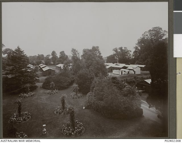 Elevated view of the rose garden of `Harefield House' which was taken over by the No. 1 Australian Auxiliary Hospital (1AAH) in 1915-03. This garden was at the side of the house behind the bay ...