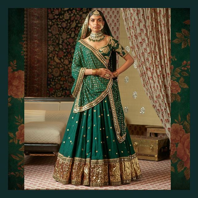 Embroidered Silk Matka Lehenga with a badla dupatta. Uncut Diamond, emeralds and pearl from the Sabyasachi heritage jewelry collection. #Sabyasachi #SabyasachiJewelry #TheWorldOfSabyasachi