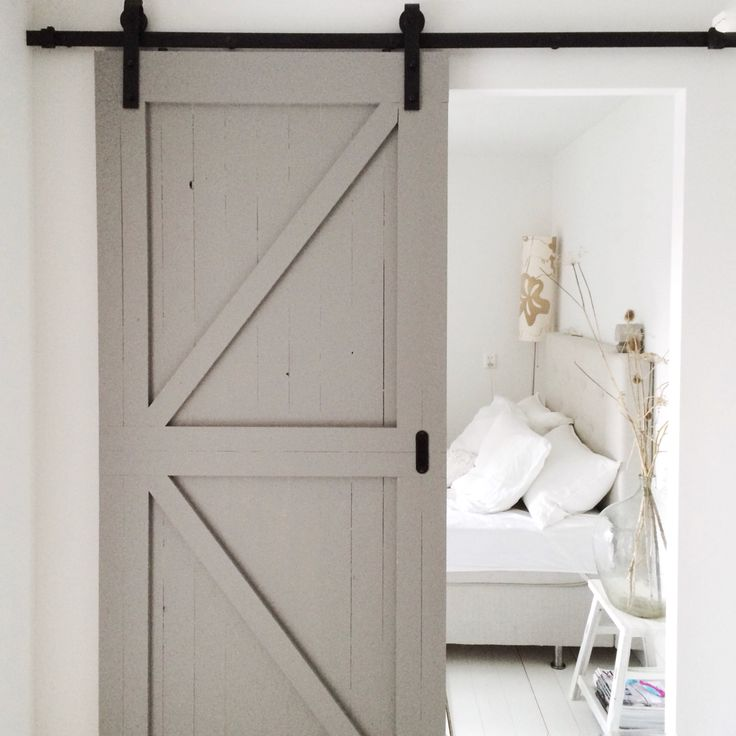 Sliding barn doors in grey for our bedroom. Styling Marit Saladini