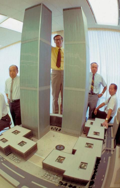 Architect Minoru Yamasaki and others pose with the model for the original World Trade Center in 1964.