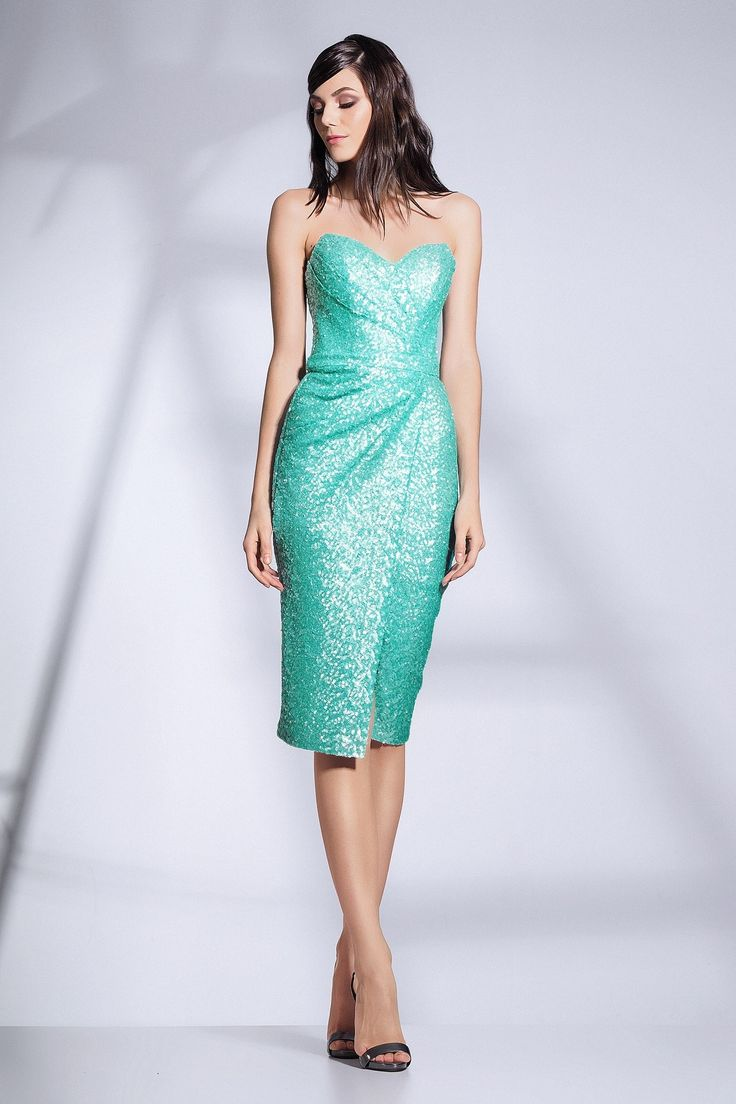 CRISTALLINI SKA369 - Dazzle and glow in this glamorous cocktail dress made out of shimmering sequins that will let you look fabulous at any special occasion! This elegant strapless dress features an exquisite sweetheart bodice with asymmetrical ruching, designed to showcase your best assets. A fashionable slim fitting skirt with asymmetrical ruching that starts from one side of the waist, will wrap your curves to the knee length hemline, ensuring a flattering and exciting silhouette. The…