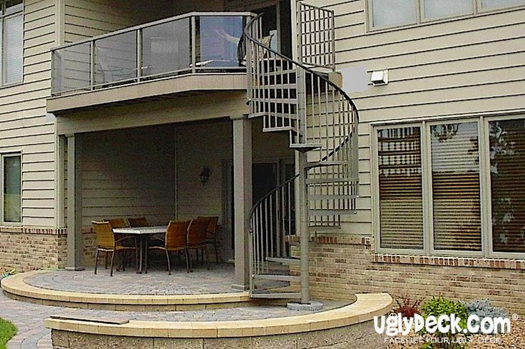Enhance a deck with spiral staircases in matching styles and colors.