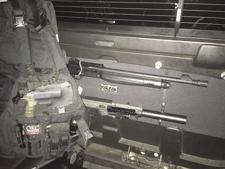 2007 Chevy Avalanche gun storage and plate carrier molle tactical vest. GSG522 with front rail system with hand grip and tactical light/laser.