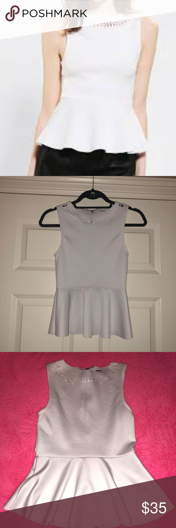 White Peplum Top with cutout neck design Zip up back white peplum tank top with cutout neck design. Worn once Sparkle & Fade Tops Tank Tops