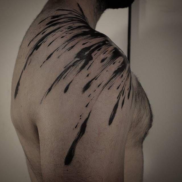 Abstract brush stroke tattoo on the right shoulder. Tattoo Artist: GAKKIN
